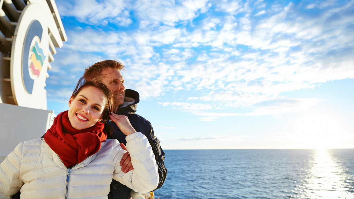 Happy couple enjoying good spring weather on a top deck of Color Line cruise ship