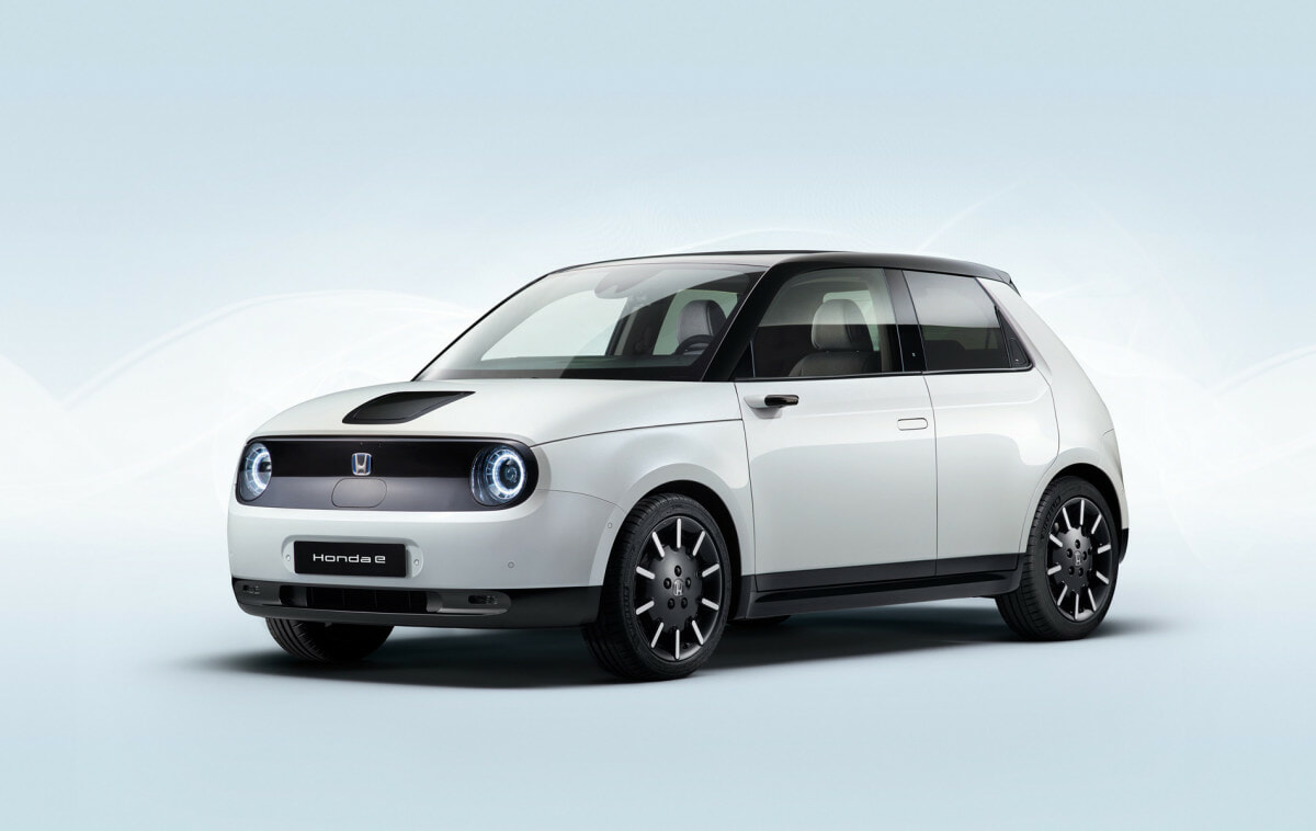 White Honda E car front right view on stylistic minimalist ambience