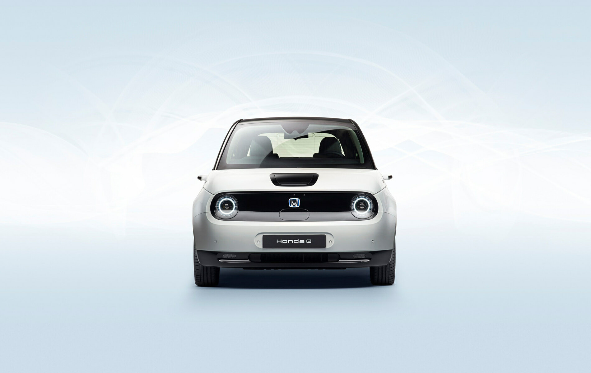 Honda E car from front on a minimalistic ambience